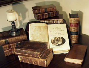 Free Picture of a Stack of Antique Books and a Pewter Candlestick