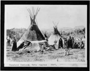 Free Photo of Shoshoni Indians Standing by Skin tipis