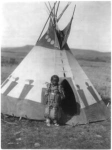 Free Photo of a Piegan Indian Girl Standing By Her Tipi