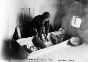 Free Photo of a Hopi Indian Woman Grinding Corn