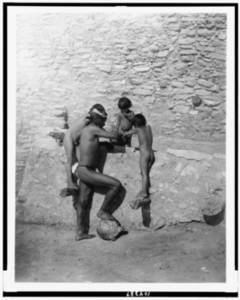 Free Photo of a Hopi Indian Brave and His Sons Eating