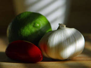 Free Picture of a Head of Garlic, A Lime, and a Pepper
