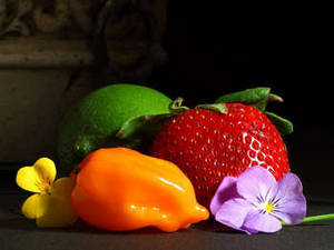 Free Picture of a Strawberry, a Lime, a Chili Pepper and Two Pansies