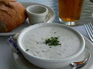 Free Photo of A Bowl of Clam Chowder with Crusty Bread