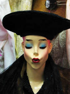 Free Photo of a Female Mannequin Wearing a Black Beret