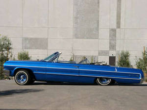 Free Photo of a Metallic Blue, 1963 Impala Convertable