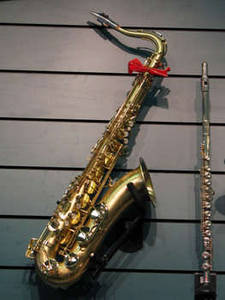 Free Picture of a Saxophone On a Show Room Wall
