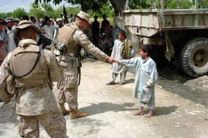 Free Picture of a Marine Shaking Hands with Afghanistanian Boy