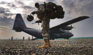Free Photo of a Soldier Boarding Hercules Aircraft, Afghanistan