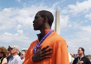 Free Photo of an African American Man, Pledging Allegiance with Washington Monument in Background