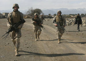 Free Picture of U.S. Marines Walking Down a Road in Khowst Province, Afghanistan