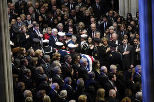 Free Picture of Gerald Ford Casket Being Carried Through Crowd