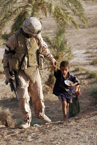 Free Picture of a Marine with an Iraqi Boy