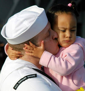 Free Picture of a United States Navy Sailor Kissing His Daughter Goodbye