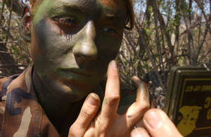 Free Picture of U.S. Airman Applying Camouflage to Her Face