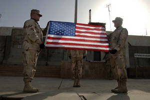 Free Picture of Two Soldiers Raising Up The American Flag