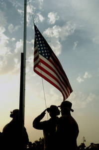 Free Picture of Soldiers Saluting the American Flag