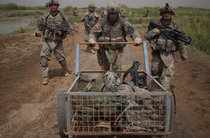 Free Picture of Army Soldiers Pushing a Weapons Cart