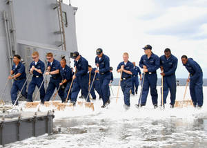 Free Picture of a Line of Navy Sailors Swabbing the Deck of Their Ship