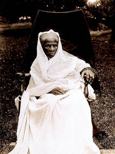 Free Photo of Harriet Tubman Sitting in a Chair, Covered With a White Blanket