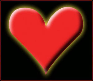Free Valentine Clipart Picture of a Glowing Heart on a Black Background