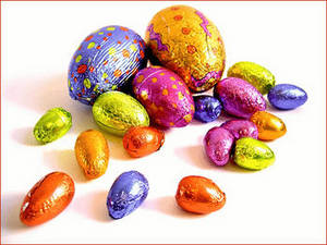 Free Clipart Picture of a Pile of Chocolate Easter Eggs