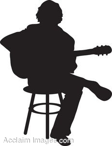 Silhouette Of An Acoustic Guitar Player