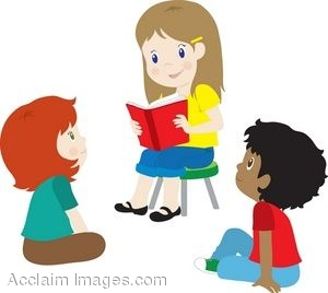 A Little Girl Reading To Other Children