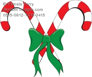 two red and white christmas candy canes with green bow