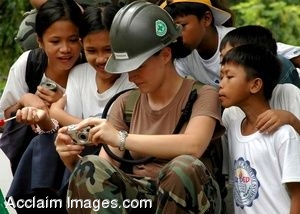 Clipart Photo of A Female Soldier With a Group of Filipino Children