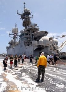 Clipart Photo of Navy Aviation Boatswains Mate Supervises a Flight Deck Wash Down