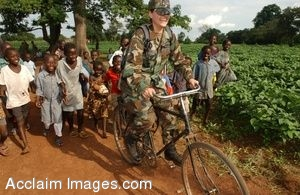 Clipart Photo of Female U.S. Soldier Riding a Bicycle With A Group Of African Children