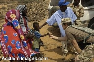 Clip Art Photo of a Female U.S. Navy Commander Handing Candy to Child in Djibouti, Africa