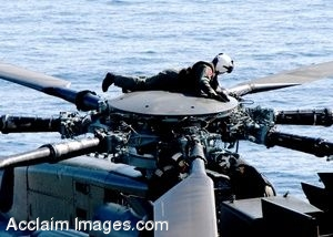 Clip Art Photo of a U.S. Navy Sailor Examining the Rotor Head of an MH-53E Sea Dragon Helicopter