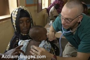 Clip Art Photo of a Navy Surgeon Treating an Infant in Ali Adde, Djibouti