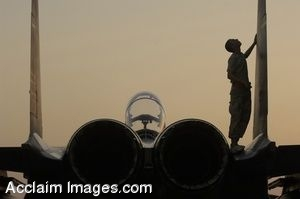 Clipart Photo of an Airman Inspecting a F-15 Strike Eagle Aircraft