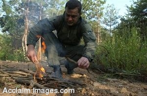Clip Art Photo of a US Soldier Starting a Campfire During Search and Rescue Training