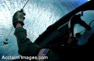 Clip Art Photo of a Navy Pilot Lowering a Sling From His Helicopter
