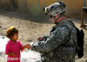 Clip Art Photo of  a U.S. Soldier Giving a Little Iraqi Girl a Piece of Gum