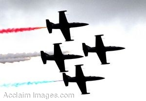 Clip Art Photo of Four L-39 Jets Flying in Formation Leaving Red, White and Blue Jet Streams Behind Them