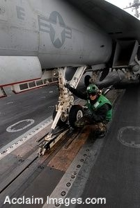 Clipart Photo of a Sailor Assisting in Guiding an F/A-18F Super Hornet Aircraft