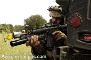 Clip Art Photo of U.S. Army Soldier With Weapon, Crouching Behind a Jeep