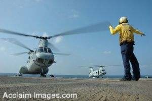 U.S. Navy Flight Crew Sailor Directing a CH-46 on Flight Deck of USS Harpers Ferry