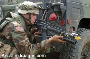 Clip Art Photo of a U.S. Army Soldier with His Weapon Behind a Jeep