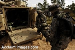 Clip Art Photo of Soldiers Loading a Simulated Casualty Into an Armored Vehicle