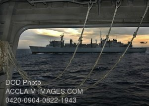 Stock Photo Clip Art Image: HH-60H Seahawk Helicopter Delivers Supplies to the USNS Bridge at Sea
