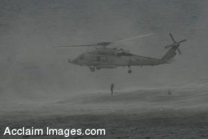 Clip Art Photo of an SH-60F Seahawk Helicopter Dropping Navy Search and Rescue Swimmers Into the Ocean