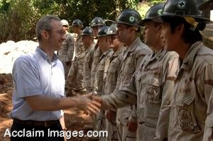 Stephen Schwartz in a Clipart Photograph Shaking Hands With Navy Seabees