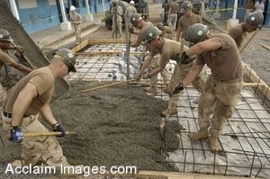 Clip Art Photo of Navy Seabees Spreading Concrete for the Foundation of a Bathroom
