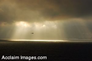 Clip Art Photo of Seahawk Helicopter Flying In Clouds